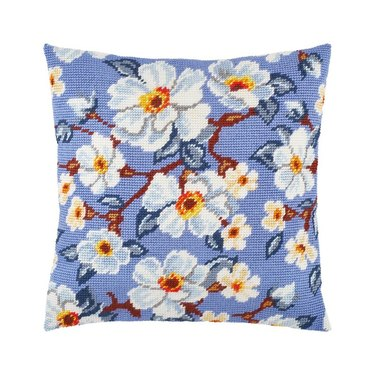 pillow with blue embroidered cover with floral pattern