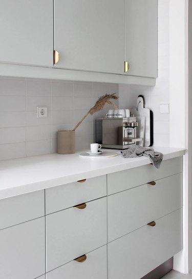 modern gray kitchen cabinets with espresso machine