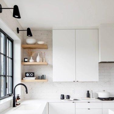 modern white kitchen with marbled white backsplash