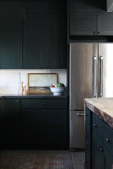 minimalist kitchen with dark cabinets and countertop decor