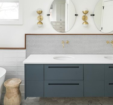 modern bathroom with trio of tile shapes and blue-gray cabinet