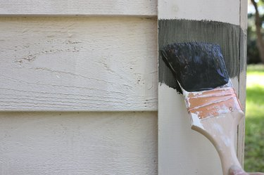 Painting shed with dark gray color called Broadway