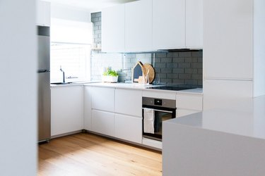 white flat panel cabinets in modern kitchen