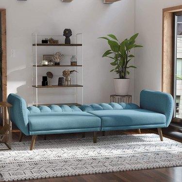 Blue futon in living room