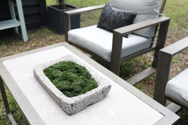 Hypertufa trough filled with moss on outdoor coffee table