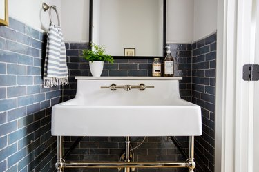white powder room with blue zellige tiled walls