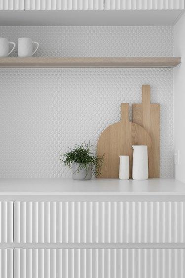 white textured backsplash and cabinets in modern kitchen