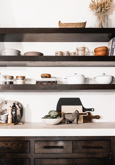 dark wood shelves and cabinets with kitchen essentials