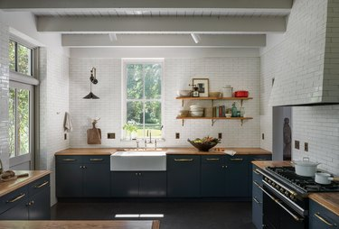 blue and white kitchen with floor-to-ceiling tile