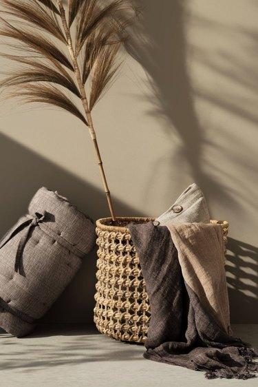linens near handmade storage basket with floral in basket