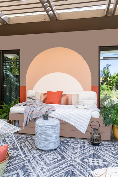 Outdoor daybed with painted mural
