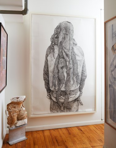 large scale hallway artwork hanging on the walls