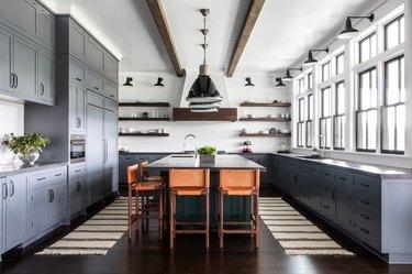 Kitchen with gray cabinets, island, shiplap backsplash