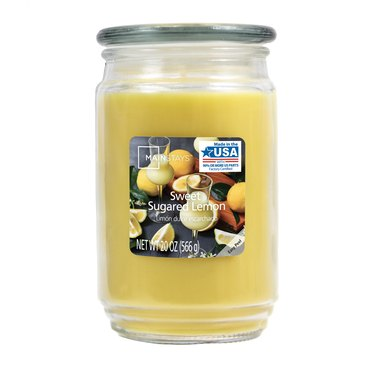 yellow lemon-scented candle in glass jar