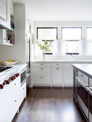 white kitchen with cafe curtains