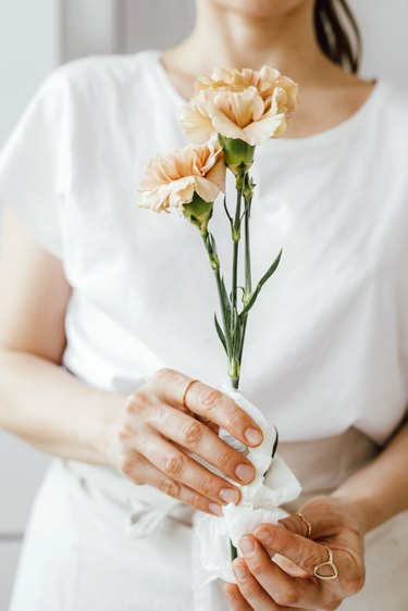 Choose hardy flowers that will last and wrap the ends in wet paper towel