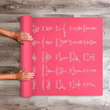 yoga mat with illustrated poses