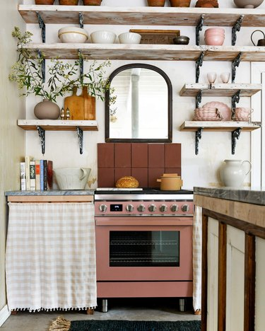 kitchen with pink stove and cabinet skirt