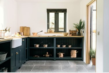 farmhouse kitchen with open shelving in place of lower cabinets