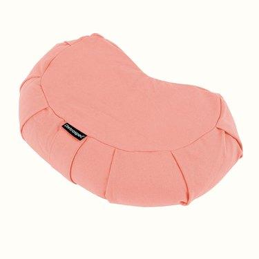 pink crescent-shaped floor pillow
