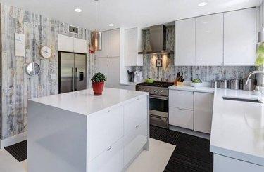 White kitchen with cabinets, gray wood backsplash