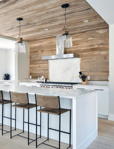 Kitchen with reclaimed wood backsplash and ceiling