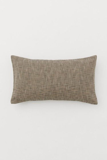 cushion with handwoven cushion cover