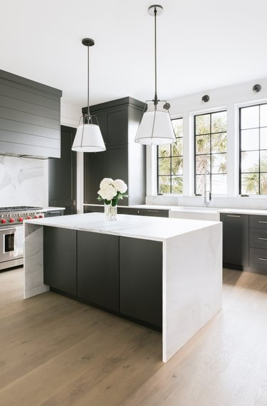 black and white kitchen with factory windows