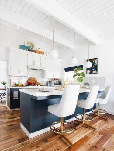 blue and white midcentury kitchen with vintage bar stools