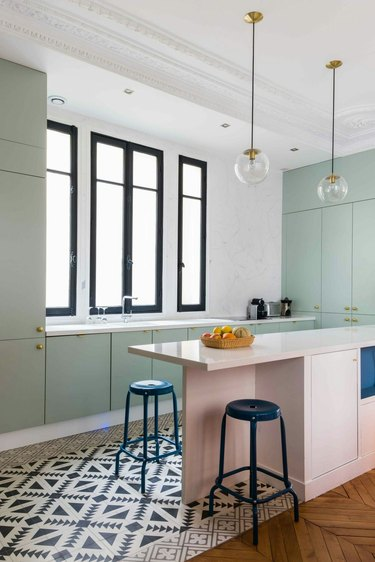white and mint green kitchen with pink kitchen island