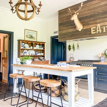 blue cabinets with wood vintage decor and white and wood island