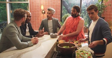the queer eye cast gathered in a kitchen area