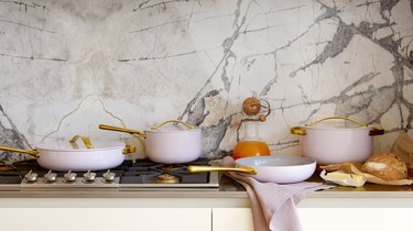 lavender cookware on stovetop and counter