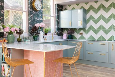 colorful kitchen with blue cabinets and pink tiled island
