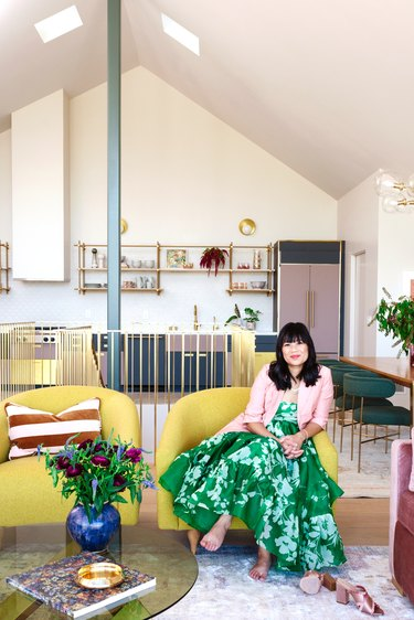 blogger Joy Cho sitting in the living room of her studio