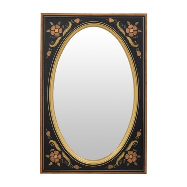 oval mirror with floral frame