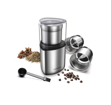 coffee grinder with beans and grounds