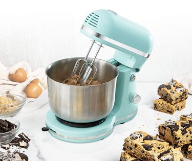 blue kitchen mixer with baked goods and ingredients
