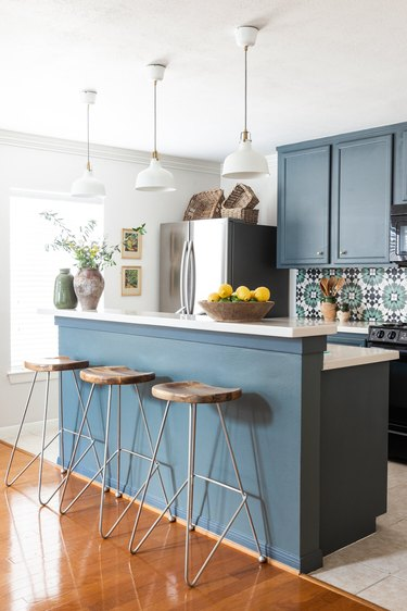 blue and white two-tier kitchen island with matching backsplash