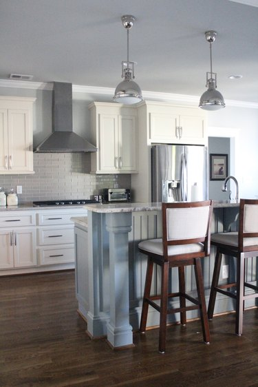 two-tier kitchen island with beadboard in white kitchen