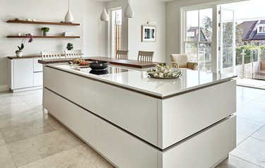 white two-tier kitchen island with small tier to use as table
