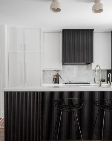 black and white kitchen with reeded details