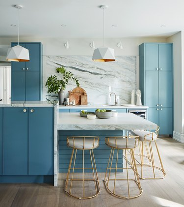 blue two-tier island with matching blue cabinetry