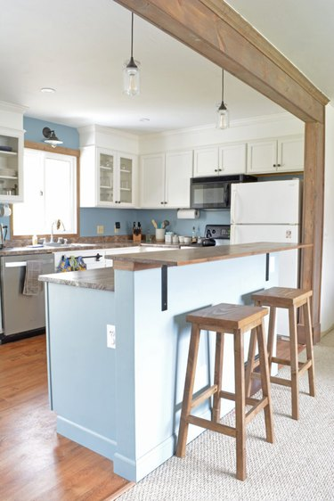 blue and wood DIY two-tier kitchen island in farmhouse kitchen