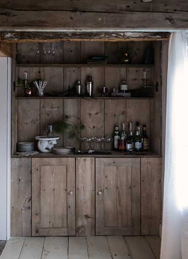moody kitchen with distressed shelving unit