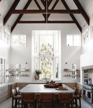 White farmhouse kitchen with high ceilings
