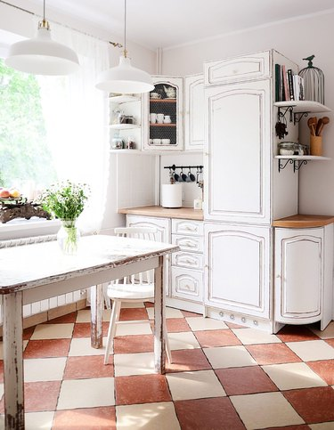 french country kitchen with checkered floor tiles