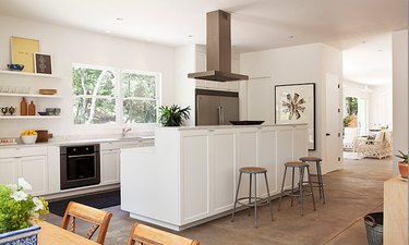 modern white two-tier kitchen island with cooktop
