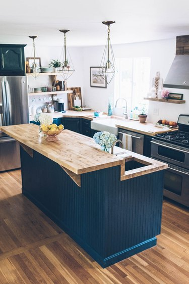 wood and navy blue two-tier island in bohemian kitchen
