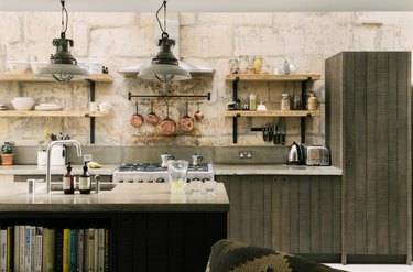 contemporary kitchen with green distressed cabinets